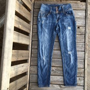 Hi-Rise Distressed 3 Button Fly Skinny Jeans